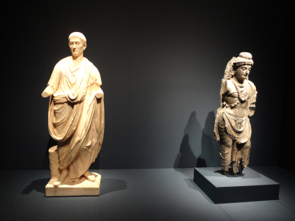 (Left) Roman Togatus, Italy, 2nd century CE, marble. (Right) Standing Bodhisattva, Gandhara region, present day Pakistan, 2nd–3rd century CE, schist.